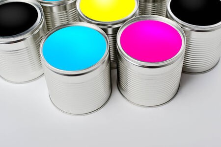 paint tin: CMYK color paint tin cans opened top view  Cyan, Magenta, Yellow and Black colors are basic for printing industry  Stock Photo