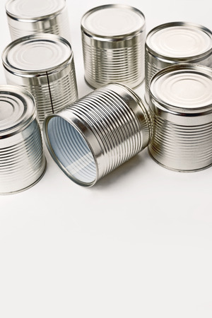 canned goods: Tin cans. Cans are used for packing all sorts of goods - conserved food, chemical products such as paint, etc Stock Photo