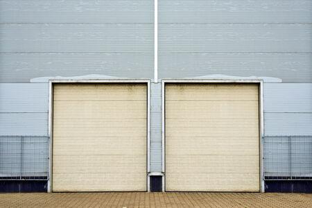 Industrial Unit with roller shutter doors. Warehouse storage doorsclosed. photo