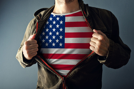 american hero: Man stretching jacket to reveal shirt with USA flag printed. Concept of patriotism and national team supporting.