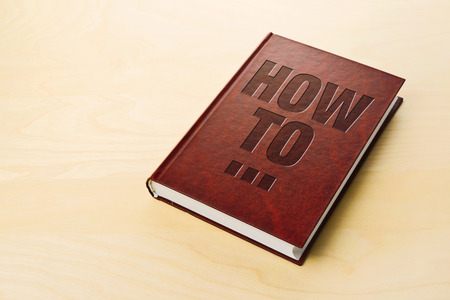 guidebook: How To book. Personl guidebook on the table.