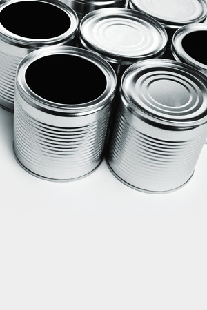 Tin cans. Cans are used for packing all sorts of goods - conserved food, chemical products such as paint, etc Banco de Imagens