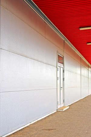 backdoor: Supermarket back door. retail and consumerism concept. Modern architecture.