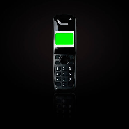 cordless phone: Wireless phone. Cordless phone with blank green screen and reflection on black gradient . Stock Photo
