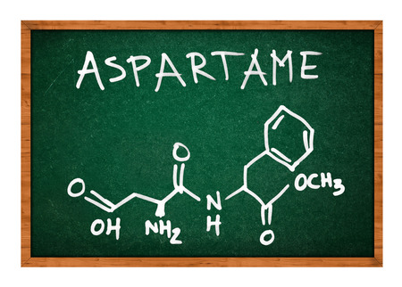 chemistry class: Aspartame chemical formula on school chalkboard isolated on white