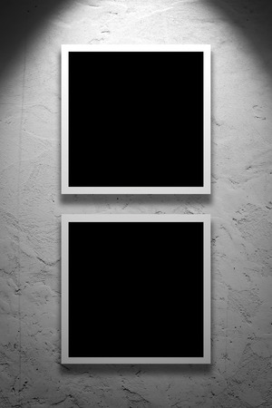Two Square Paintings hanging on the art gallery white wall. photo