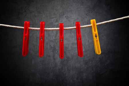 singular: Clothes pins on the rope. Standing out from the crowd.