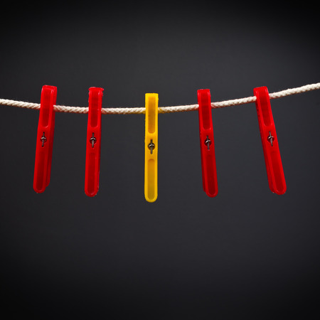 Clothes pins on the rope. Standing out from the crowd.