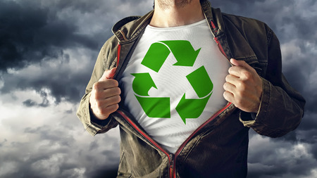 reveal: Man stretching jacket to reveal shirt with recycle symbol printed