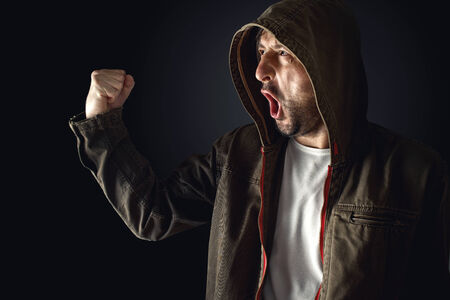 Male Protester Shouts at Riot Act on the Streets. Stock Photo - 28710174