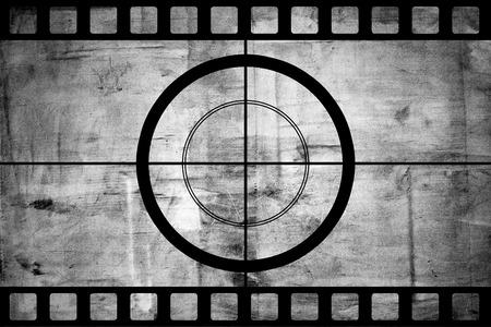Vintage movie film strip with countdown border over grunge background photo
