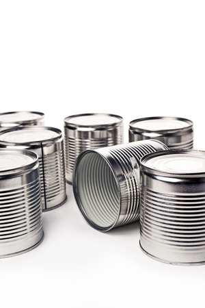 conserved: Tin cans. Cans are used for packing all sorts of goods - conserved food, chemical products such as paint, etc Stock Photo