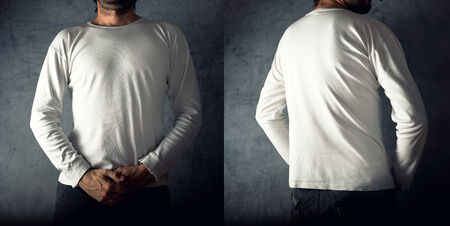 Slim tall man posing in blank white t-shirt, front and back view, as copy space for your text or design. Stock Photo - 28800752