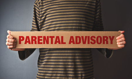 unsuitable: Casual Man holding Parental advisory message printed on cardboard paper Stock Photo