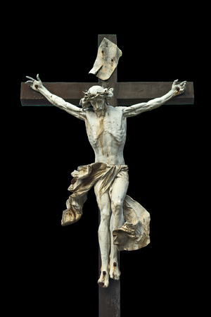 Crucifixion  Christian cross with Jesus Christ statue isolated on black background with clipping work path  Religion and spirituality concept  Stock Photo