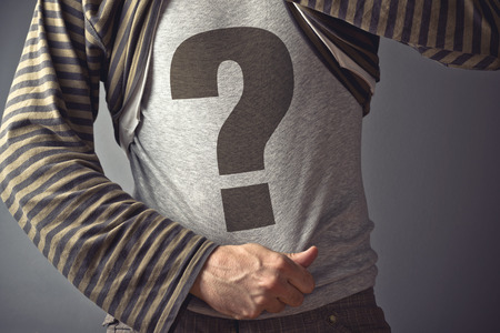 questioning: Questioning concept  Casual man showing question mark printed on his shirt