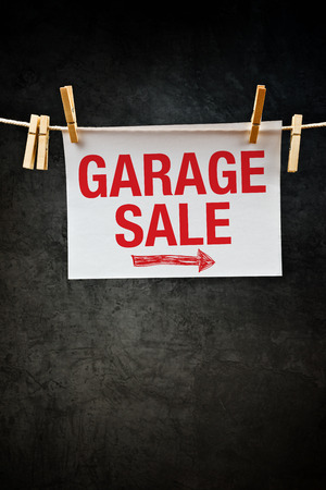 Garage Sale sign attached to rope with clothes pins