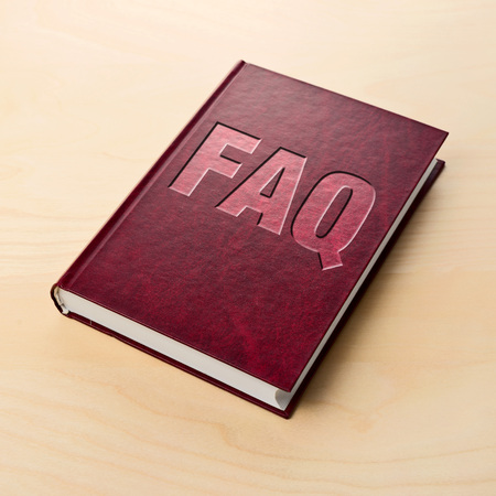 frequently asked question: FAQ book. Frequently asked question or printed guide on the table.