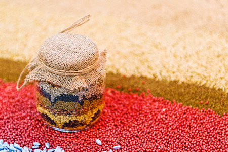 seeds of various: Various agricultural seeds in jar as agriculture seeding season abstract.