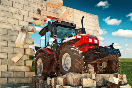 agronomics: Brand new Tractor, powerfull agricultural working machine breaking through wall. Overcoming all obstacles in farming and agriculture production.