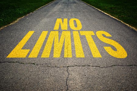 safety signs: No Limits message on asphalt road. Concept of safe driving and preventing traffic accident. Stock Photo