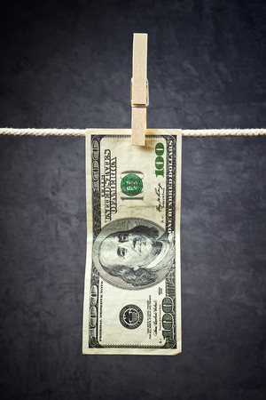 American currency  USA money, Dollar bills hanging on rope attached with clothes pins  photo