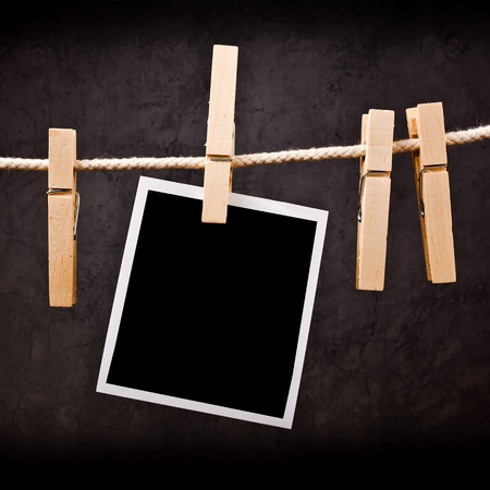 clothes pin: Photography paper with instant photo frame attached to rope with clothes pins  Copy space for your image