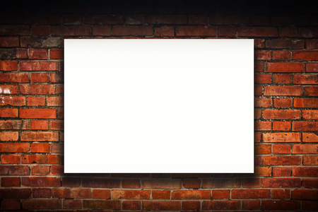 outdoor advertising: Blank poster on old brick wall. Outdoor advertising copy space. Stock Photo