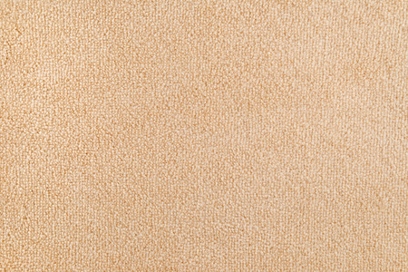 New carpet texture. Bright Beige carpet flooring as seamless background.