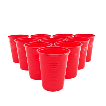 Empty Plastic red cups on white background photo