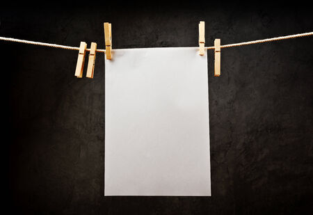 placement: Blank note paper hanging on rope with clothes pins, copy space for your text or image or product placement.
