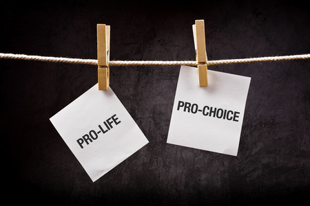 Pro-life vs pro-choice, female right on abortion concept