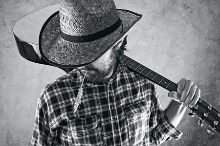 country lifestyle: Western country cowboy musician with guitar, black and white portrait