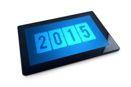 2015 on Generic Tablet PC display over white background  Happy New Year with modern technology high tech gadget in media era  photo
