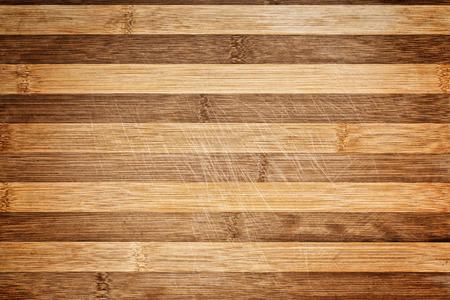 carnicero: Cortante de bloque de carnicero y la tabla de madera de cortar como fondo. Textura de madera.