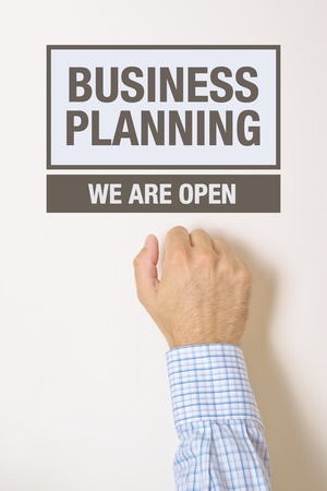 knocking: Businessman knocking on Business Planning Office door looking for a help and advice.