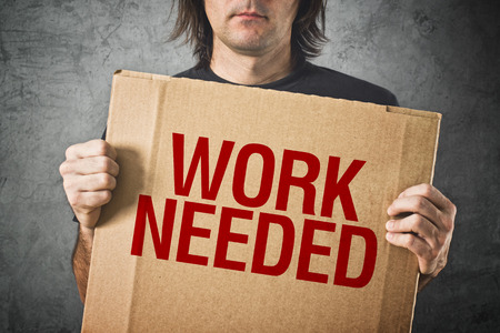 pauper: Man needs a job  Unemployed man holding board with title WORK NEEDED Stock Photo