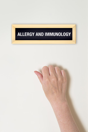 immunotherapy: Female hand is knocking on Allergy and Immunologyt door for a medical exam