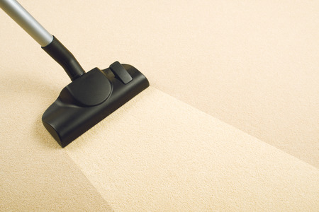 Vacuum Cleaner sweeping Brand New Carpet  Housework and home hygiene  Archivio Fotografico