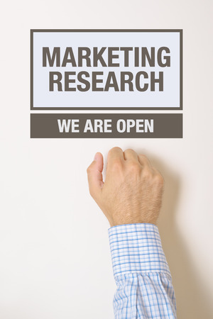 quantitative: Businessman knocking on Marketing Research office door looking for a help or advice