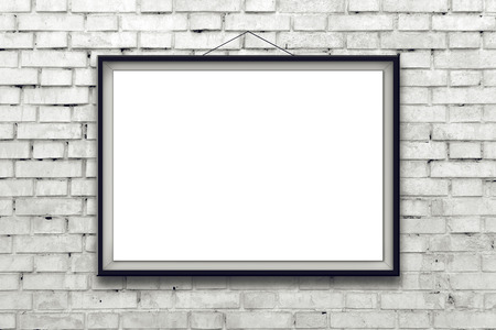Blank horizontal painting poster in black frame hanging on white brick wall. Painting proportions match international paper size A.
