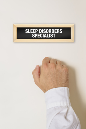 sleep disorder: Male patient knocking on Sleep Disorder Specialist door for a medical exam. Stock Photo