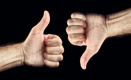 disapprove: Thumb down and thumb up for like and dislike or Approval and disapproval concept. Stock Photo