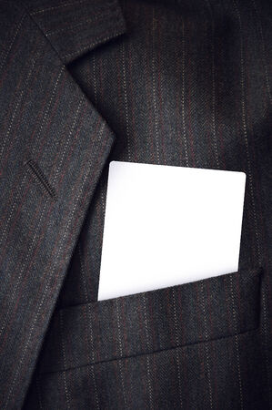 Blank visiting business card in businessman corporate suit pocket. Copy space template for design or text. photo