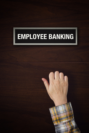 knocking: Female Hand is knocking on Employee Banking door, conceptual image.
