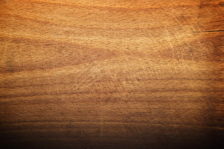 Worn butcher block cutting and chopping wooden board as background. Wood texture.