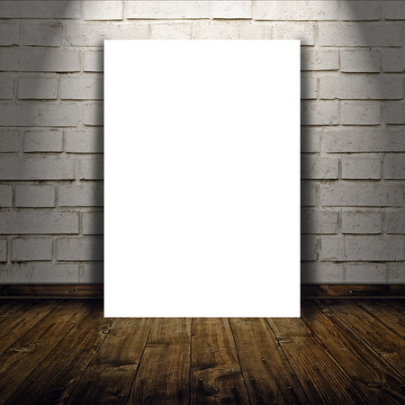 Blank poster as copy space template for your artwork or design in Vintage empty Room interior with white brick brick wall and wooden floor below the spot light. Stockfoto
