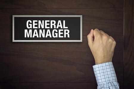 Businessman is knocking on General Manager door for an interview Standard-Bild