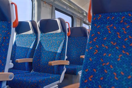 intercity: Interior of european economy class passenger train with empty seats. Stock Photo