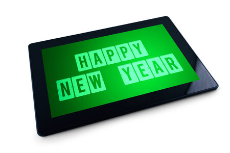 Happy New Year message on Generic Tablet computer display. Happy New Year with modern technology high tech gadget in media era. photo
